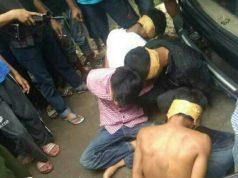 Tersangka begal asal Lamoung dingkus polisi dibantu waga di Cikupa, Tangeang, Kamis (19/4/2018). Foto: Istimewa