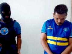 Kepala Lapas Kalianda mengenakan seragam tahanan setelah ditetapkan sebagai tersangka kasus 5 kg sabu-sabu dan 5.100 butir pil ekstasi.
