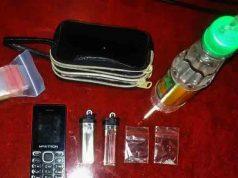 barang bukti dua paket sabu dan lainnya yang disita dari tersangka HE (36)