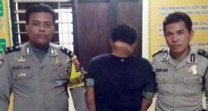 RD (28), warga Kelurahan Kuripan, Kecamatan Kota Agung yang ditangkap warga dan sempat diamuk massa diamankan di Mapolsek Talang Padang, Tanggamus.