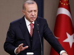 Presiden Turki Recep Tayyip Erdogan menyampaikan pidato selama konferensi pers menjelang keberangkatannya ke Prancis sebagai bagian dari Forum Perdamaian Paris untuk menandai peringatan 100 tahun berakhirnya Perang Dunia I, di Bandara Internasional Esenboga di Ankara, Turki pada 10 November 2018. ( Murat Kaynak - Anadolu Agency )