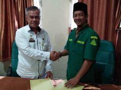 Penandatangan nota kerjasama Disdukcapil Kabupaten Waykanan dengan GP Ansor tentang dukungan mewujudkan Waykanan sebagai kabupaten layak anak.
