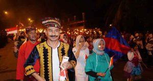 Kemeriahan pawai obor dalam rangka memperingati HUT kemerdekaan ke-74 RI di Lampung Selatan, Jumat malam, 16 Agustus 2019.