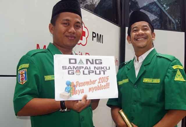 Bendahara PC GP Ansor Abdullah Candra Kurniawan kiri dan Ketua PC GP Ansor Gatot Arifianto kanan mengampanyekan anti golput Dok GP Ansor Way Kanan Foto Disisi Saidi Fatah