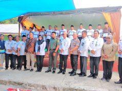 Bupati Tanggamus Dewi Handajani beserta jajaran photo bersama dengan 12 kepala pekon..