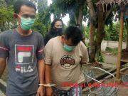 RI dan DT, dua oknum anggota Satpol PP Lampung Utara, menuju ruang tahanan Mapolres Lampung Utara.