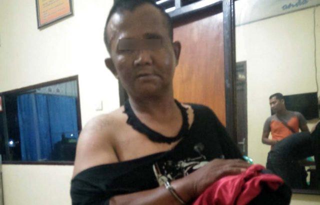 Tersangka Sudira (55), pelaku penculikan dan pemerkosaan gadis remaja saat diamankan petugas di Mapolres Lampung Selatan.