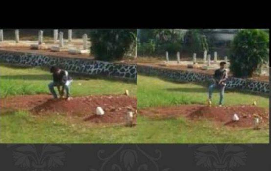 Tangkapan layar video amatir aksi remaja laki - laki yang mencoba mencabut nisan dari salah satu makam pahlawan di Kotabumi, Lampung Utara.